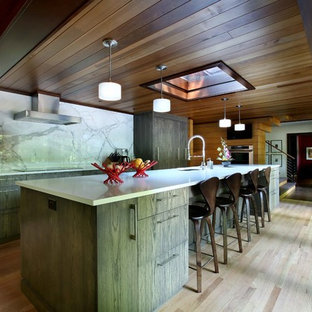 Mid-sized contemporary enclosed kitchen inspiration - Example of a mid-sized trendy single-wall light wood floor and beige floor enclosed kitchen design in Grand Rapids with an undermount sink, flat-panel cabinets, dark wood cabinets, quartz countertops, white backsplash, stone slab backsplash, paneled appliances and an island