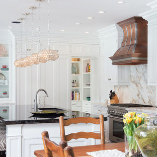 This is an example of a large contemporary l-shaped kitchen/diner in Austin with a submerged sink, white cabinets, granite worktops, white splashback, stone slab splashback, stainless steel appliances, medium hardwood flooring, an island and recessed-panel cabinets.
