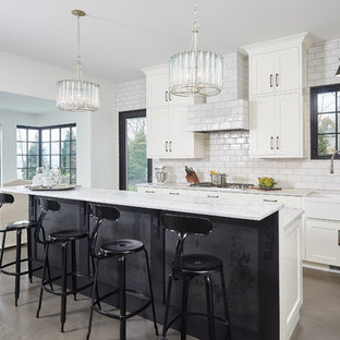 Large contemporary eat-in kitchen ideas - Inspiration for a large contemporary single-wall concrete floor and gray floor eat-in kitchen remodel in Grand Rapids with a farmhouse sink, shaker cabinets, white cabinets, marble countertops, white backsplash, subway tile backsplash and an island