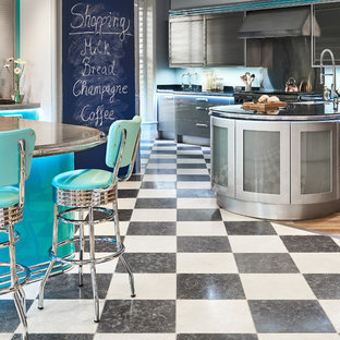 Inspiration for a midcentury kitchen in Wiltshire with limestone floors.