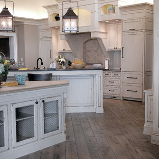 Huge coastal eat-in kitchen ideas - Inspiration for a huge coastal u-shaped medium tone wood floor, brown floor and vaulted ceiling eat-in kitchen remodel in Chicago with an undermount sink, beaded inset cabinets, white cabinets, granite countertops, multicolored backsplash, ceramic backsplash, two islands and black countertops