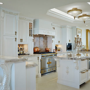 Victorian u-shaped open plan kitchen in Miami with recessed-panel cabinets, white cabinets, beige splashback, stone slab splashback, with island, beige floor and beige benchtop.