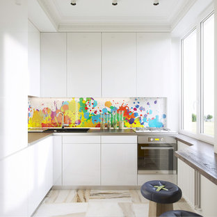 Inspiration for a small contemporary l-shaped kitchen remodel in Moscow with a drop-in sink, flat-panel cabinets, white cabinets, multicolored backsplash, stainless steel appliances and no island