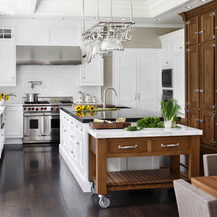 Inspiration for a large timeless u-shaped dark wood floor eat-in kitchen  remodel