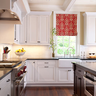 Kitchen - traditional kitchen idea in Atlanta with a farmhouse sink, beaded inset cabinets, white cabinets, white backsplash, subway tile backsplash and stainless steel appliances