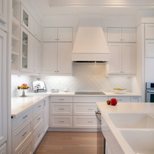 Traditional kitchen designs - Kitchen - traditional kitchen idea in Toronto with white cabinets and white backsplash