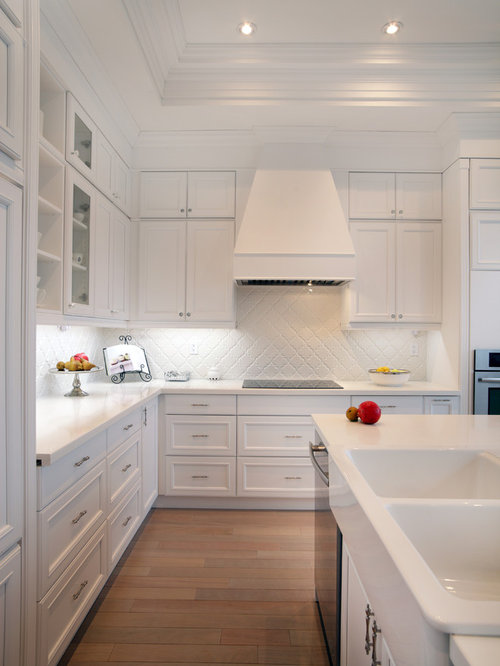 Traditional Kitchen Idea In Toronto With White Cabinets And White Backsplash
