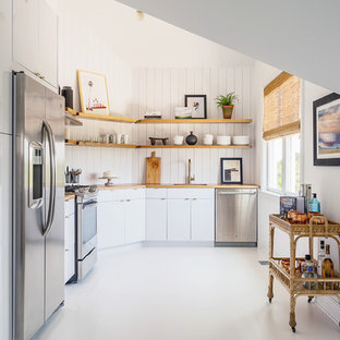Beach Style Kitchen Ideas   Inspiration For A Beach Style Painted Wood  Floor And White Floor