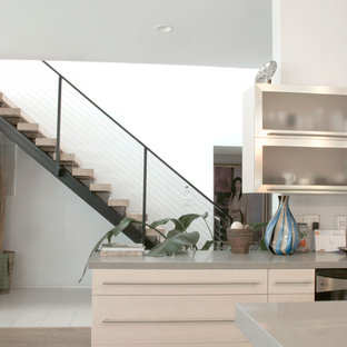 Large contemporary eat-in kitchen designs - Inspiration for a large contemporary u-shaped light wood floor eat-in kitchen remodel in Los Angeles with an undermount sink, flat-panel cabinets, light wood cabinets, quartz countertops, gray backsplash, porcelain backsplash, an island and stainless steel appliances