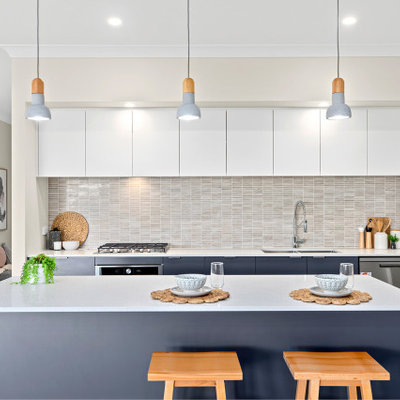 Kitchen - contemporary galley medium tone wood floor and brown floor kitchen idea in Other with an undermount sink, flat-panel cabinets, white cabinets, gray backsplash, mosaic tile backsplash, stainless steel appliances, an island and white countertops