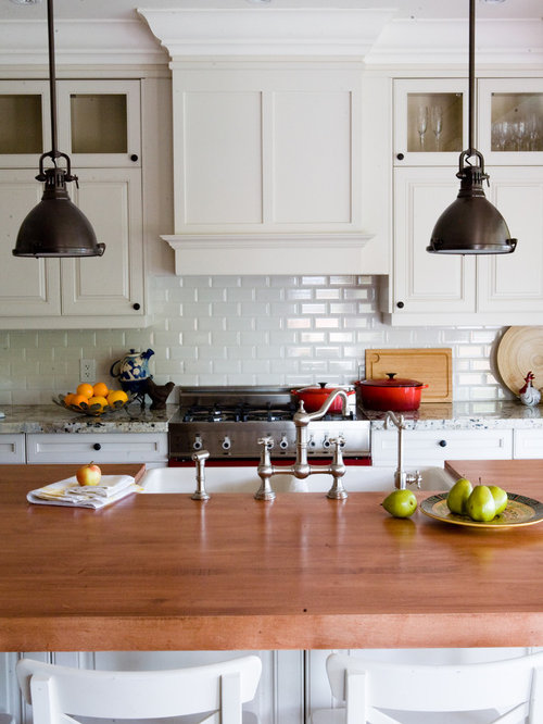 Example Of A Classic Kitchen Design In Toronto With Wood Countertops, A  Double Bowl