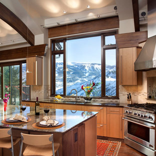 Mid-sized trendy l-shaped medium tone wood floor eat-in kitchen photo in Denver with stainless steel appliances, an undermount sink, flat-panel cabinets, medium tone wood cabinets, granite countertops, beige backsplash, ceramic backsplash, an island and brown countertops