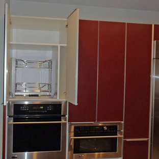 Mid-sized contemporary eat-in kitchen inspiration - Example of a mid-sized trendy porcelain floor eat-in kitchen design in Hawaii with an undermount sink, flat-panel cabinets, red cabinets, granite countertops, metallic backsplash, porcelain backsplash and stainless steel appliances