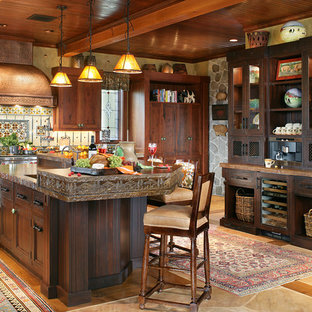 Inspiration for a large country u-shaped eat-in kitchen in New York with an integrated sink, recessed-panel cabinets, distressed cabinets, concrete benchtops, panelled appliances and medium hardwood floors.