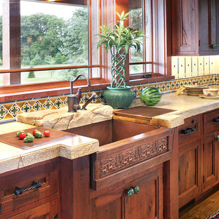 Inspiration for a large rustic u-shaped medium tone wood floor eat-in kitchen remodel in New York with an integrated sink, recessed-panel cabinets, distressed cabinets, concrete countertops and paneled appliances