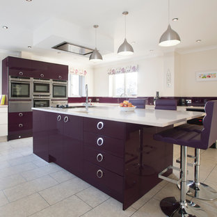 This is an example of a large contemporary kitchen in Other with an integrated sink, flat-panel cabinets, quartzite benchtops, glass tile splashback, stainless steel appliances, vinyl floors and with island.