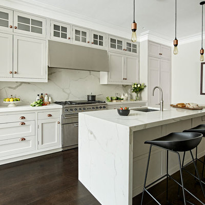 Eat-in kitchen - mid-sized transitional single-wall dark wood floor and brown floor eat-in kitchen idea in London with shaker cabinets, gray cabinets, marble countertops, gray backsplash, stainless steel appliances, an island, an undermount sink, gray countertops and marble backsplash