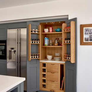 This is an example of a medium sized classic kitchen in Surrey with shaker cabinets, grey cabinets, stainless steel appliances and grey floors.