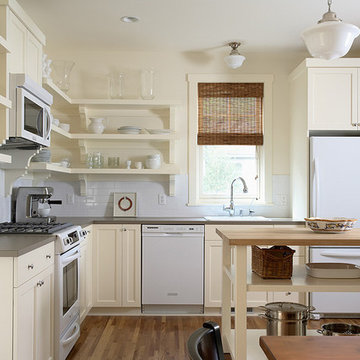 Quaint painted kitchen with open shelving