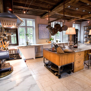This is an example of an expansive industrial l-shaped open plan kitchen in Philadelphia with stainless steel appliances, marble benchtops, a farmhouse sink, shaker cabinets, white cabinets, with island, marble floors, grey floor and white benchtop.