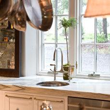 Industrial Kitchen by Jarrett Design, LLC