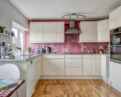 foto e idee per cucine  cucina con paraspruzzi rosa, Disegni interni