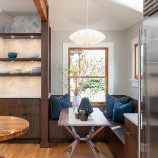 Mid-sized midcentury modern eat-in kitchen inspiration - Mid-sized 1960s medium tone wood floor eat-in kitchen photo in Seattle with white backsplash, stone tile backsplash, open cabinets and dark wood cabinets