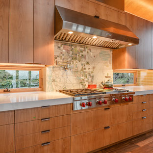 Mid-sized minimalist medium tone wood floor eat-in kitchen photo in Seattle with a double-bowl sink, flat-panel cabinets, medium tone wood cabinets, beige backsplash, ceramic backsplash, stainless steel appliances and an island