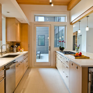 Contemporary eat-in kitchen remodeling - Trendy galley light wood floor eat-in kitchen photo in Seattle with an undermount sink, flat-panel cabinets, light wood cabinets, multicolored backsplash, matchstick tile backsplash, stainless steel appliances, solid surface countertops and no island