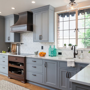 Large traditional kitchen pictures - Kitchen - large traditional medium tone wood floor and brown floor kitchen idea in Seattle with an undermount sink, beaded inset cabinets, blue cabinets, quartz countertops, white backsplash, mosaic tile backsplash and paneled appliances