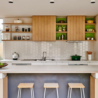 Beach style kitchen in Geelong with a drop-in sink, open cabinets, light wood cabinets, white splashback, stainless steel appliances, with island and white benchtop.