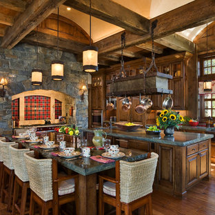 Rustic eat-in kitchen photos - Eat-in kitchen - rustic eat-in kitchen idea in Other with raised-panel cabinets, dark wood cabinets and red backsplash