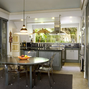 Mid-sized industrial eat-in kitchen designs - Mid-sized urban l-shaped concrete floor eat-in kitchen photo in Atlanta with an undermount sink, stainless steel cabinets, granite countertops, black backsplash, glass tile backsplash, stainless steel appliances and an island