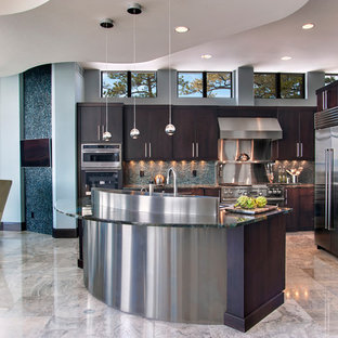 Inspiration for a large modern l-shaped open plan kitchen in New York with an undermount sink, flat-panel cabinets, dark wood cabinets, quartz benchtops, blue splashback, stone slab splashback, stainless steel appliances, porcelain floors, with island, beige floor and blue benchtop.