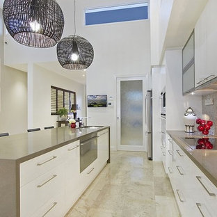 Photo of a large galley eat-in kitchen in Brisbane with an undermount sink, open cabinets, white cabinets, quartz benchtops, beige splashback, mosaic tile splashback, black appliances, travertine floors, with island, beige floor and brown benchtop.