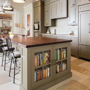 Inspiration for a large country kitchen in Nashville with a farmhouse sink, recessed-panel cabinets, green cabinets, wood benchtops, stainless steel appliances, with island, beige floor and slate floors.