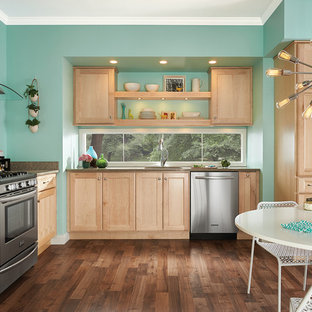 Eat-in kitchen - eclectic l-shaped medium tone wood floor eat-in kitchen idea in Detroit with an undermount sink, shaker cabinets, light wood cabinets, stainless steel appliances and no island