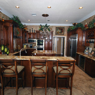 Eat-in kitchen - traditional u-shaped eat-in kitchen idea in Other with an undermount sink, raised-panel cabinets, dark wood cabinets, wood countertops, beige backsplash, stone slab backsplash and stainless steel appliances