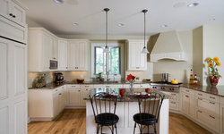 Raised Panel White Brookhaven Cabinet Kitchen with Center Island and Stucco Hood