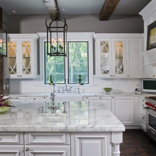 Raised Panel, White Cabinet Kitchen with Oversize Island, Hand Hewn Ceiling Beam