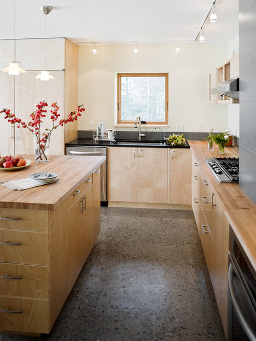 Contemporary L Shaped Kitchen Idea In Burlington With Wood Countertops,  Flat Panel Cabinets