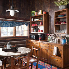 Rustic Kitchen by North Fork Builders of Montana, Inc.