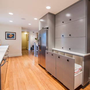 Inspiration for a mid-sized midcentury u-shaped kitchen in Portland with an undermount sink, flat-panel cabinets, grey cabinets, concrete benchtops, white splashback, cement tile splashback, stainless steel appliances and bamboo floors.