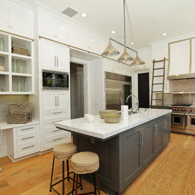Example of a trendy kitchen design in Los Angeles with stainless steel appliances and subway tile backsplash