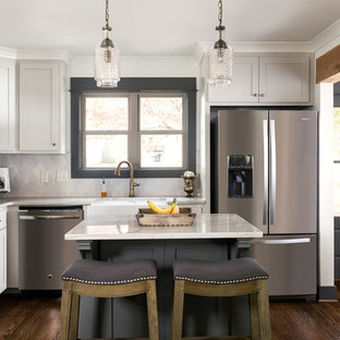 Transitional kitchen inspiration - Kitchen - transitional l-shaped dark wood floor kitchen idea in Birmingham with a farmhouse sink, shaker cabinets, gray cabinets, gray backsplash, stainless steel appliances and an island