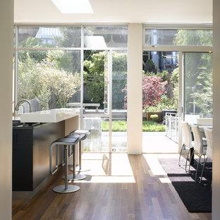Minimalist dark wood floor and brown floor eat-in kitchen photo in San Francisco