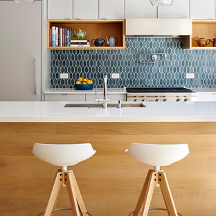 Large contemporary kitchen appliance - Example of a large trendy light wood floor and beige floor kitchen design in San Francisco with an undermount sink, flat-panel cabinets, white cabinets, quartz countertops, blue backsplash, stainless steel appliances and an island