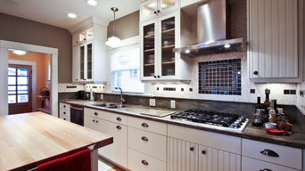 Range hood and backsplash anchor this new, bright kitchen