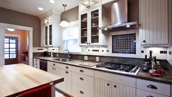 Range hood and backsplash anchor this new, bright kitchen