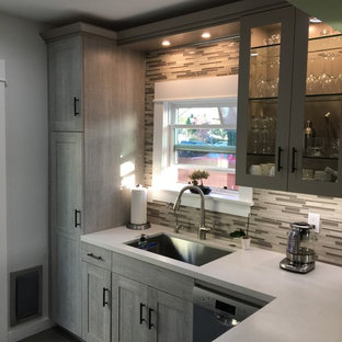 Photo of a small midcentury galley separate kitchen in San Diego with an undermount sink, shaker cabinets, light wood cabinets, quartz benchtops, multi-coloured splashback, glass sheet splashback, stainless steel appliances, porcelain floors and a peninsula.